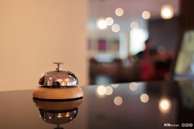 Bell on a hotel counter. Photo.