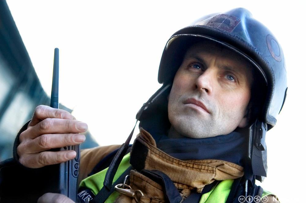 Portrett av brannmann. Foto.