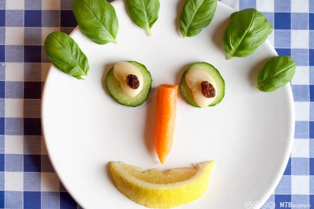 Ansikt laget av grønnsaker