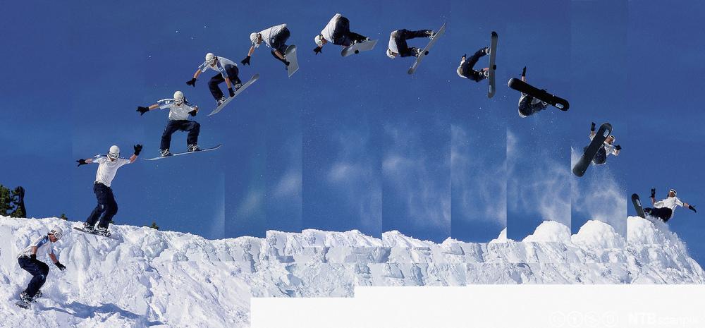 En som hopper 360 på snøbrett. Foto.