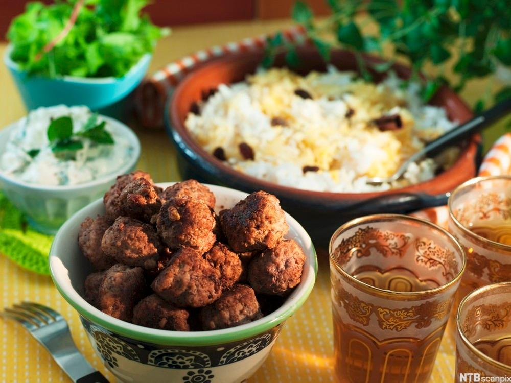 Indian meatballs with saffron rice. Photo.