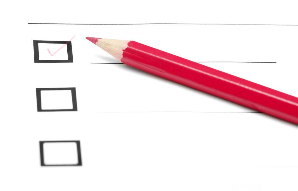 En sjekkliste og en blyant. Foto.