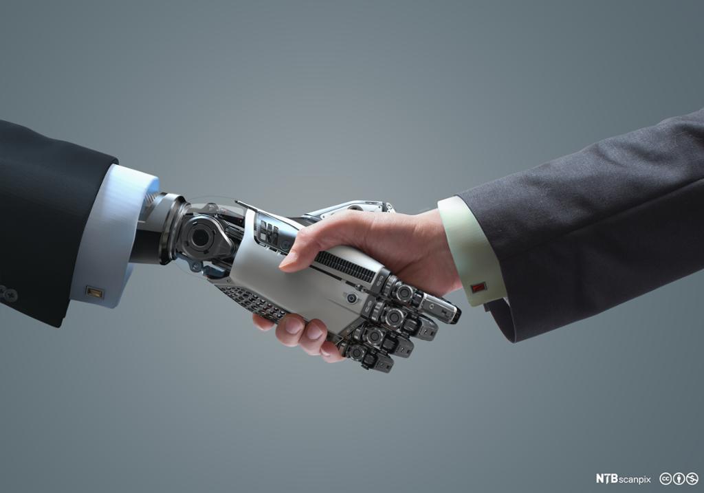 Robot og menneske håndhilser. Foto.