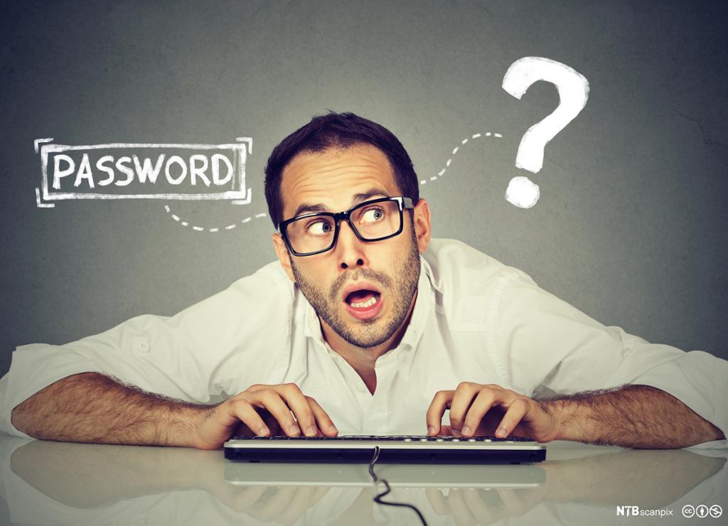 Mann med tastatur har passordproblemer. Foto.