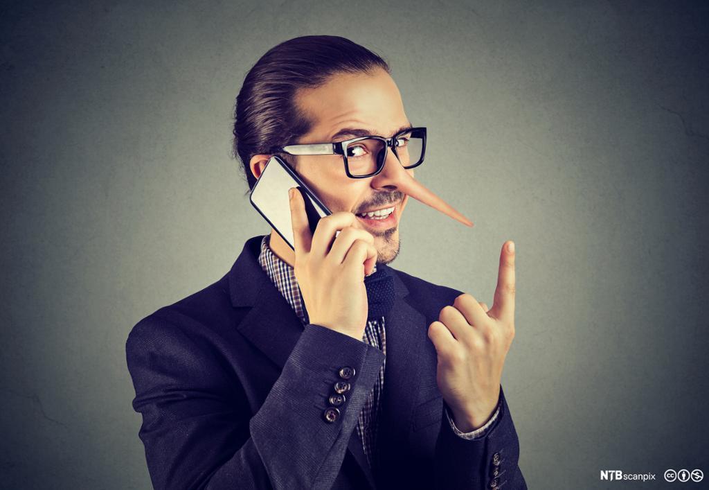 Mann med lang nese som snakker i mobiltelefon. Foto.