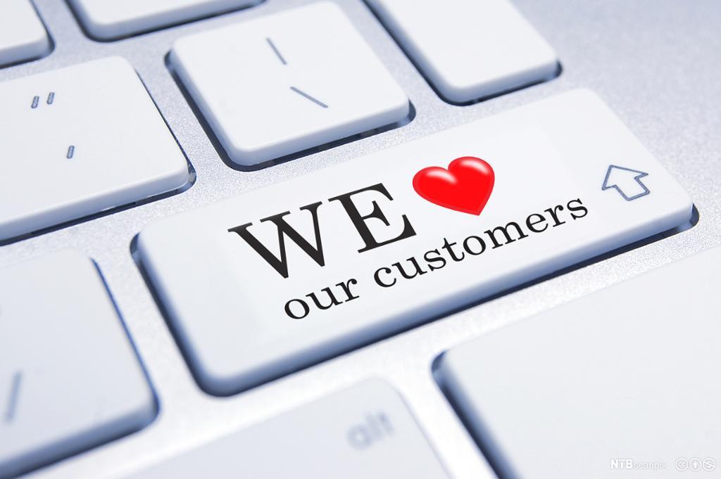 Tastaturknapp med teksten: We love our customers