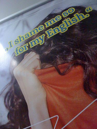 "English Course Ad with text: ""I shame me so for my English."" Photo."