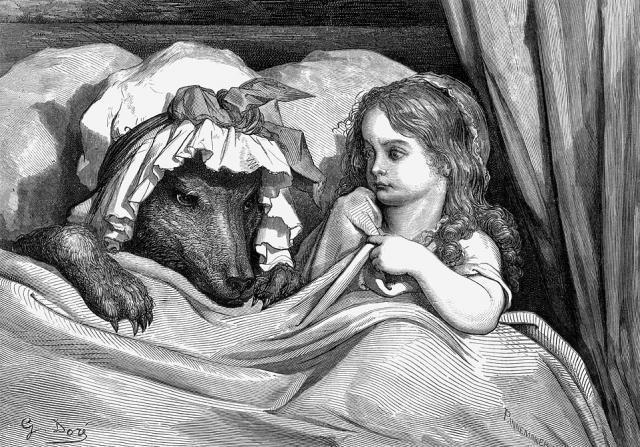 Rødhette i senga sammen med ulven som er utkledd som bestemor. Illustrasjon