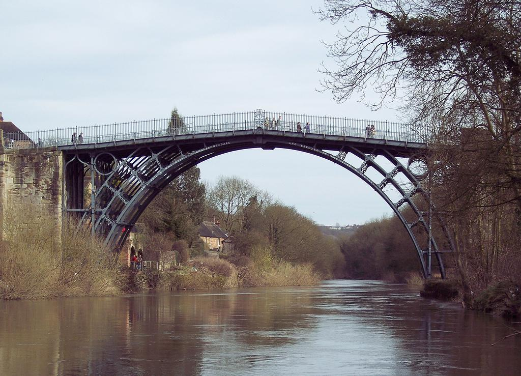 Ironbridge over slow river. Photo.
