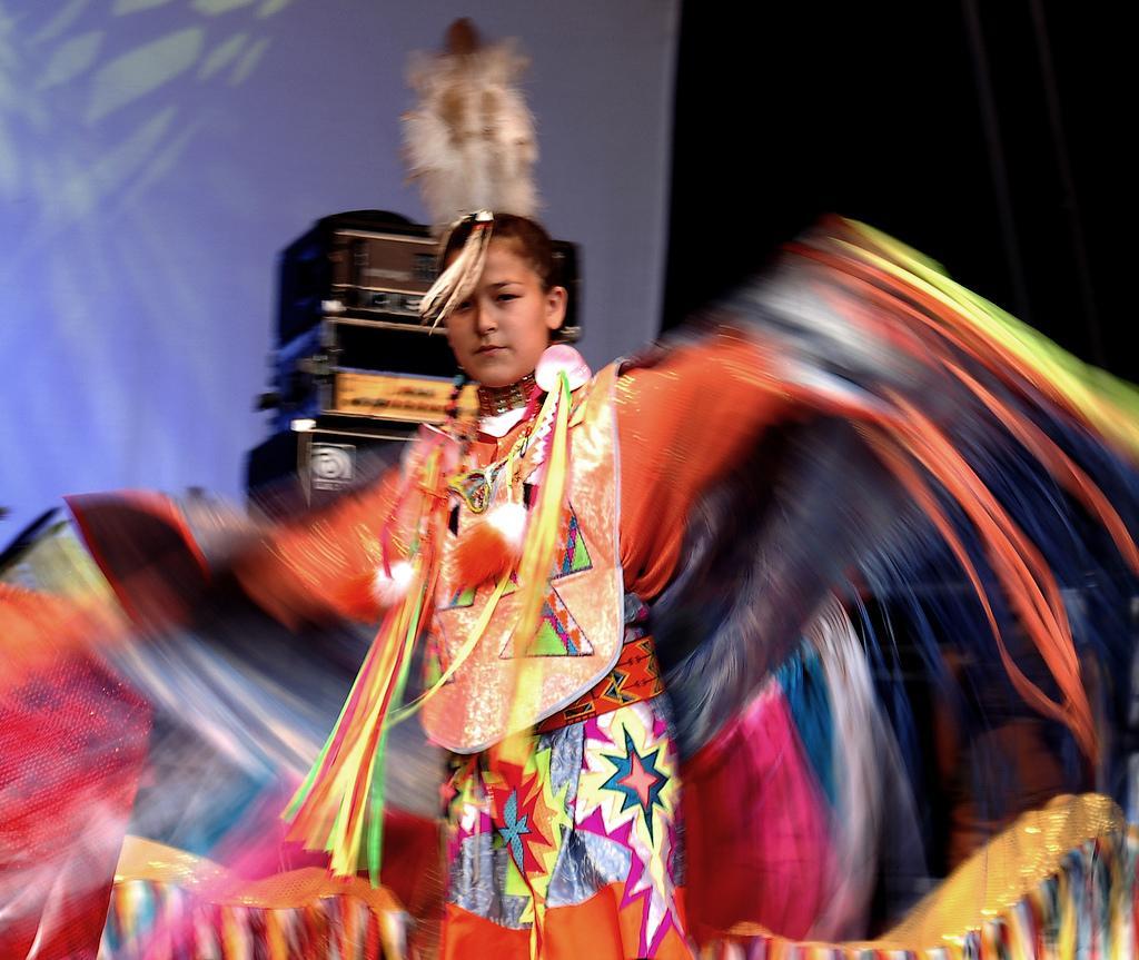 Saskatchewan dancer in a colourful costume. Photo.