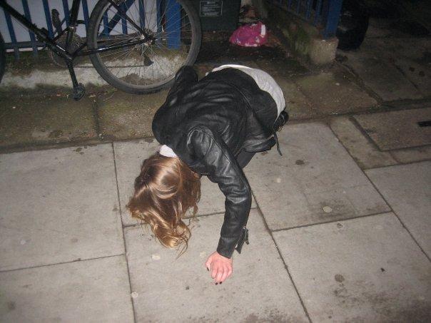 Teenage girl falling on pavement. Photo.