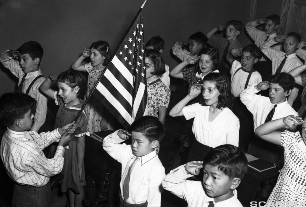 Children in New York with roots in many different cultures saluting the American flag