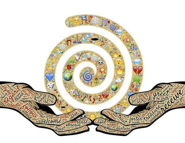 Hender som holder en spiral  med ikoner. Foto.