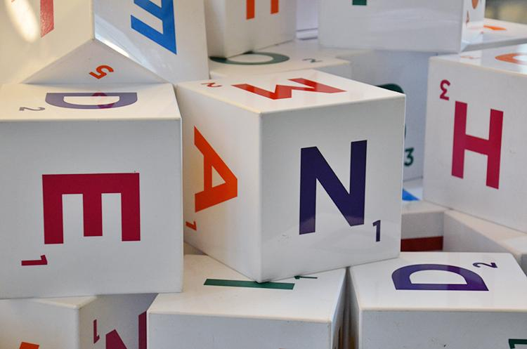 Wooden blocks with printed letters. Photo.
