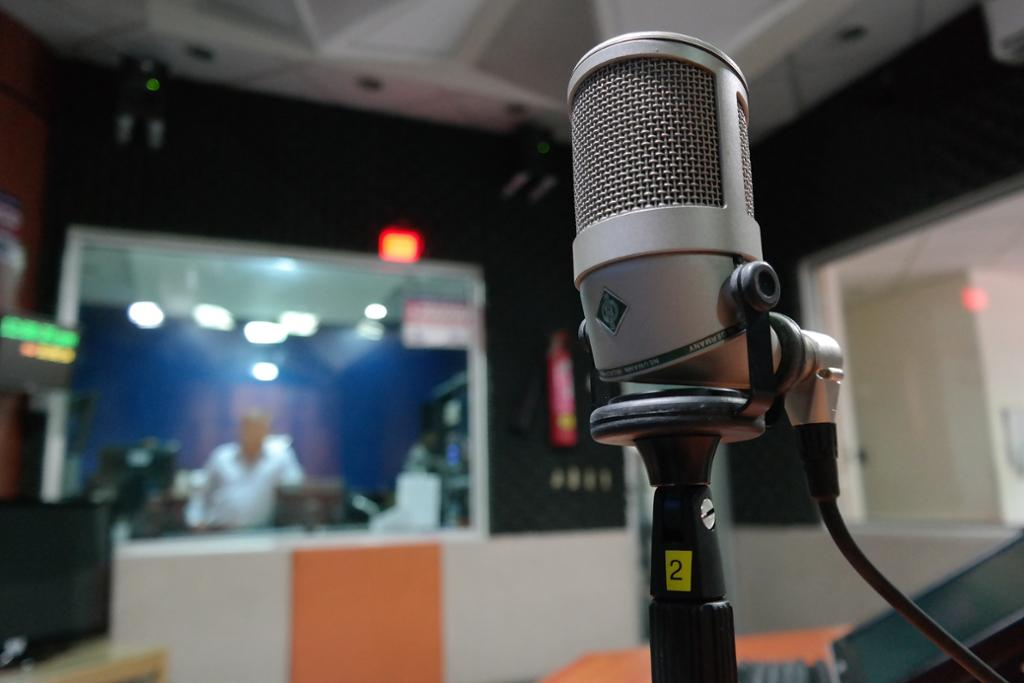 A microphone in a recording studio. Photo.