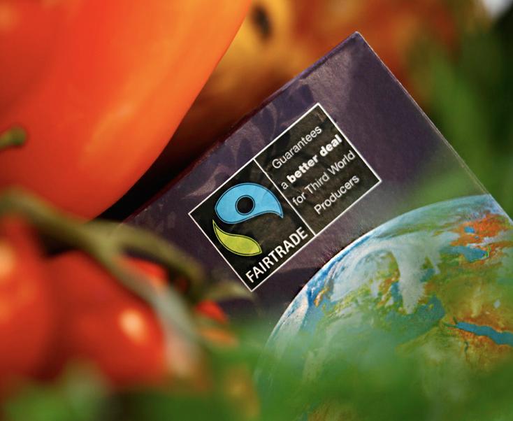 Bilde av fairtrade sin logo blant tomater