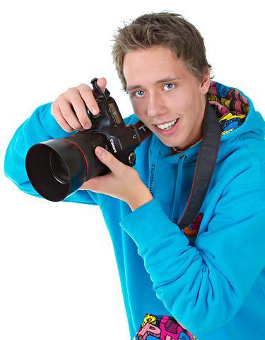 Fotograf med kamera. Foto.