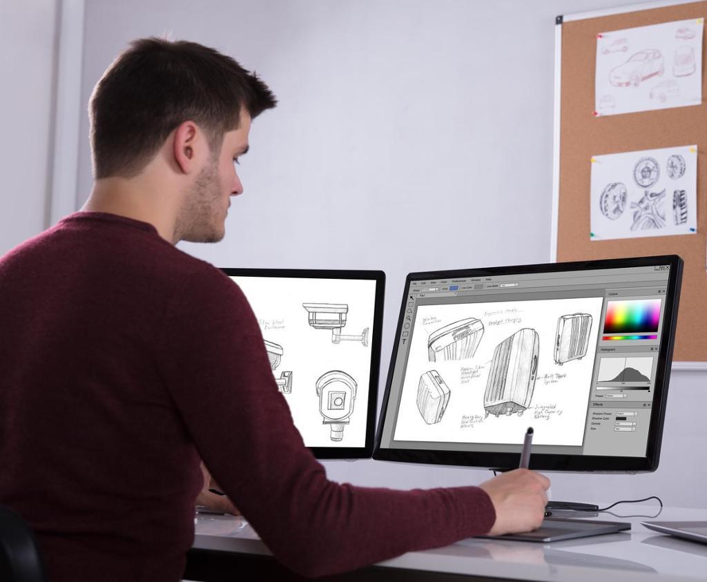 Designer jobber i et tegneprogram. Foto.