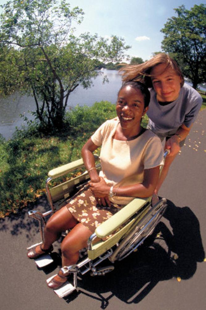 Girl in a wheelchair. Photo.