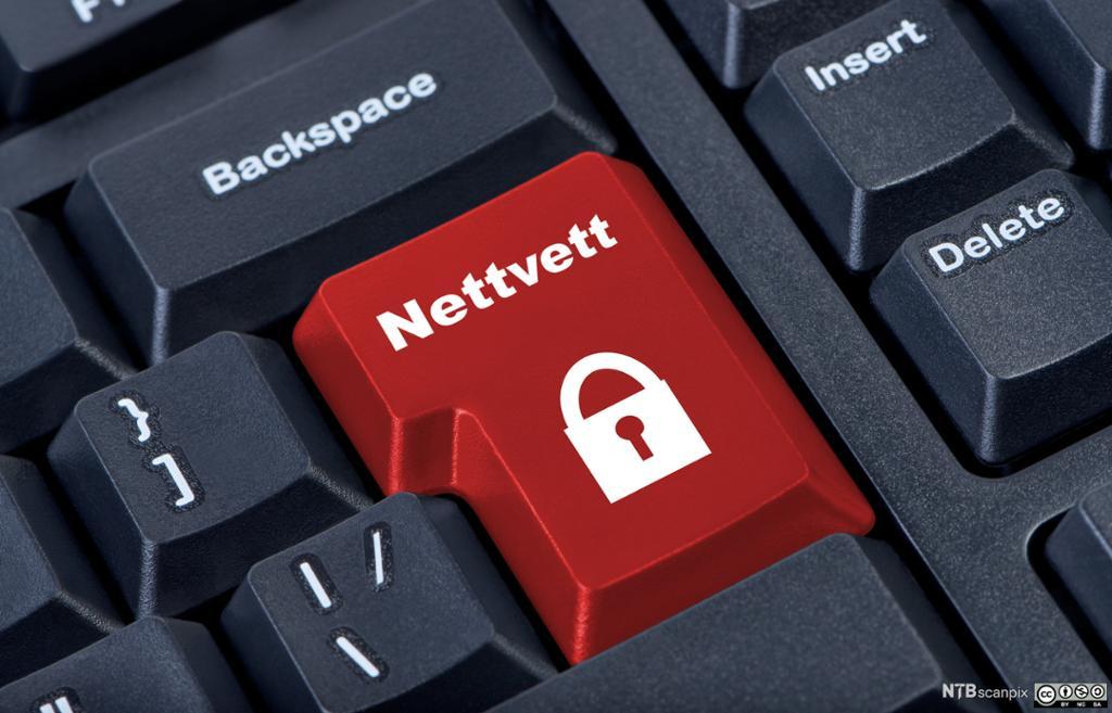 """Tastatur med rød tast for """"Nettvett"""" og ikonet av en hengelås. Manipulert foto."""