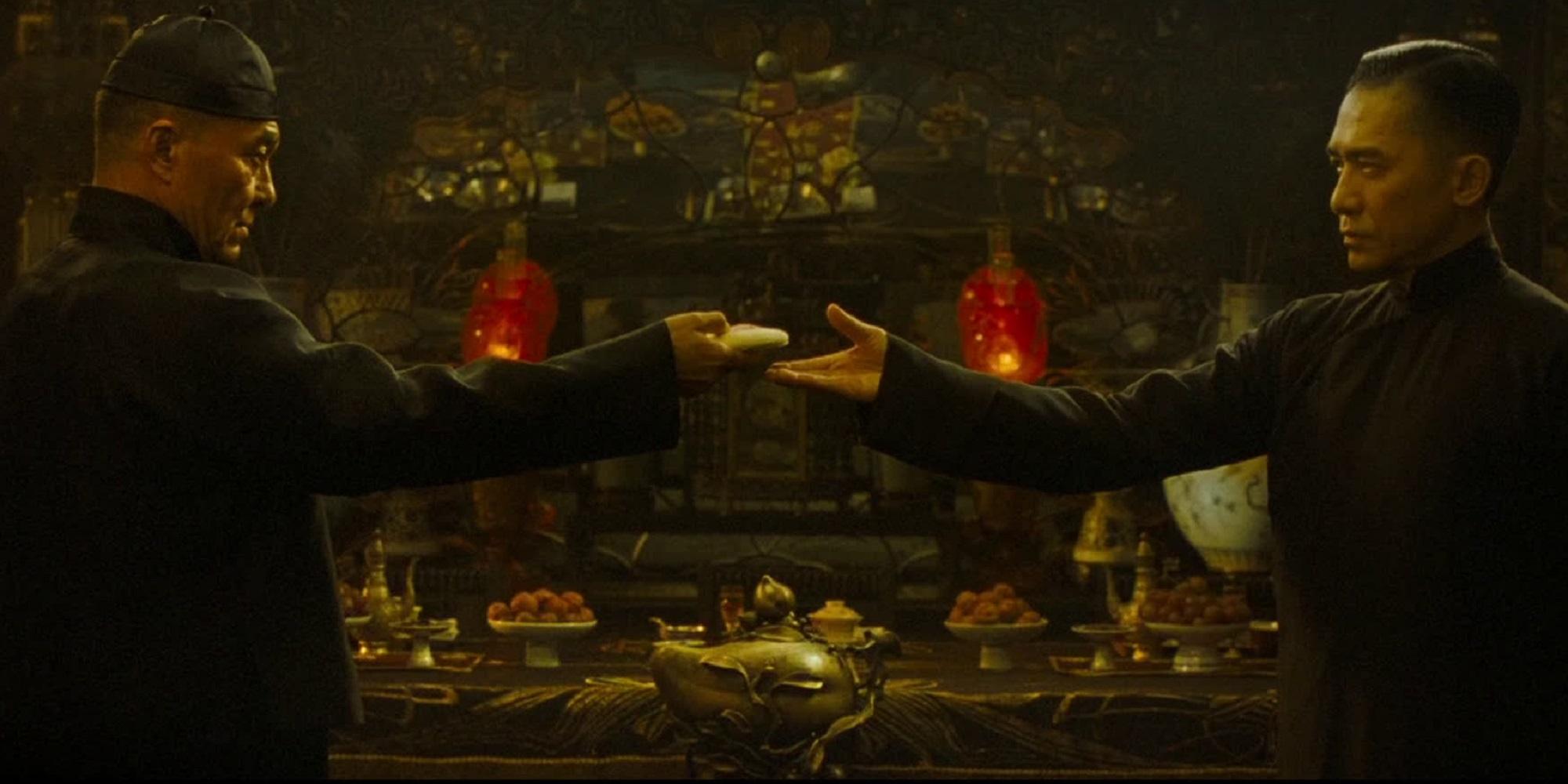 To asiatiske menn i sorte klær fra filmen The Grandmaster. Foto.