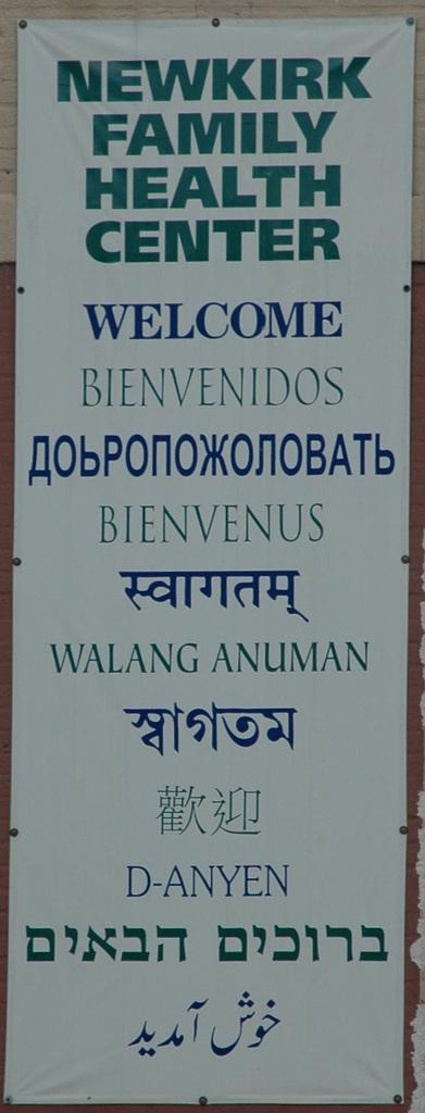 Multilingual welcome sign. Photo.