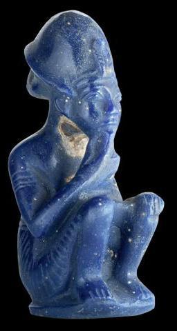 Blå glassfigur av farao fra graven til Tutankhamon. Foto.
