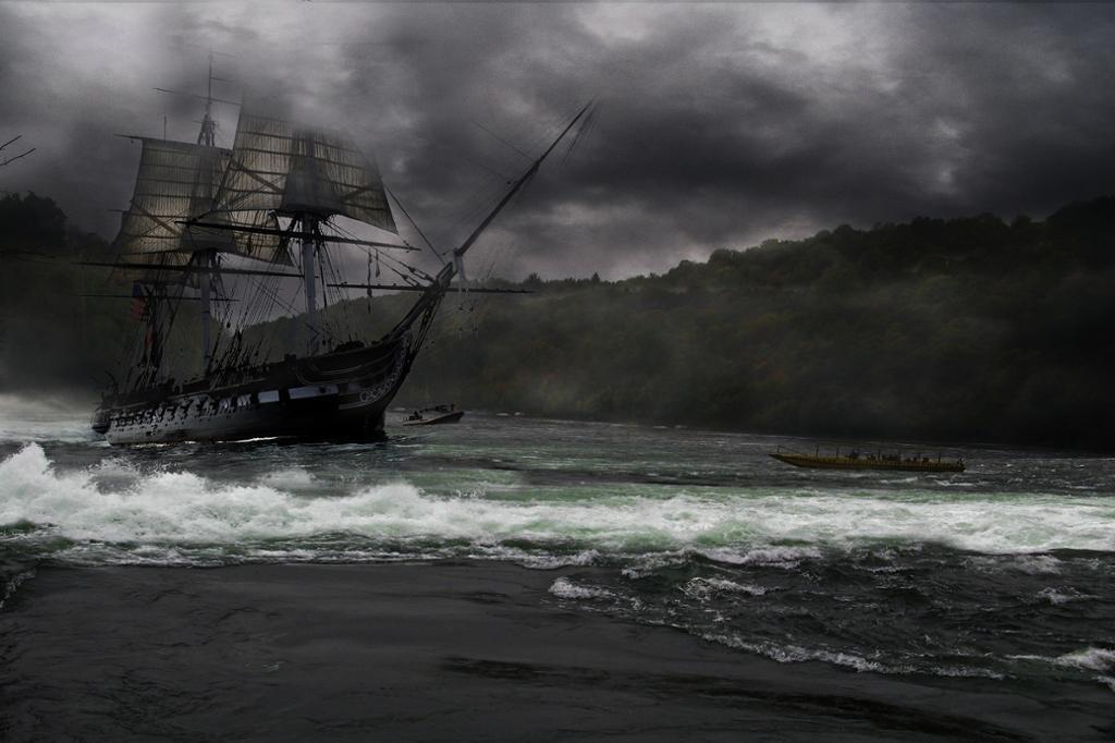Seilskip med tre master i dårlig vær, men ikke langt fra land. Foto.