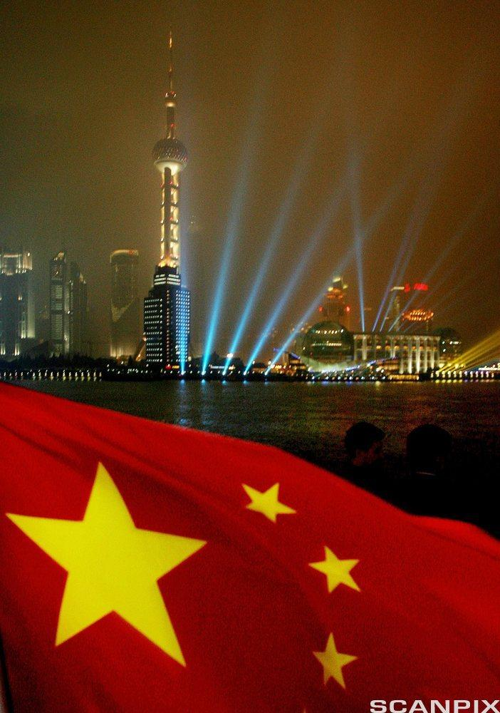 Chinese flag with Pudong skyline, Shanghai in background