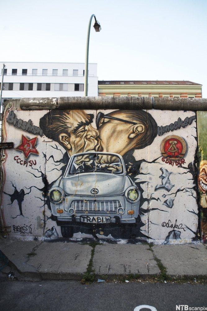 Brezhnev and Honecker on the Berlin Wall. In front an East German Trabant