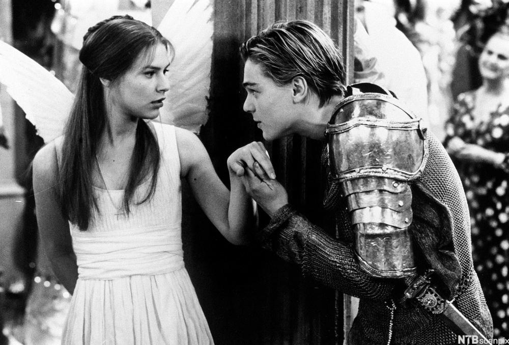 "Scene from the movie ""Romeo and Juliet"" where Romeo meets Julie for the first time at a party arranged by the Capulet family. Photo."