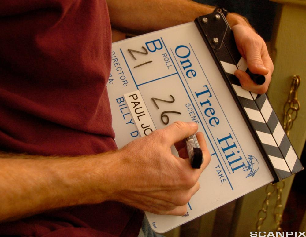 "Johnny McIntyre fills out the slate for the next scene in ""One Tree Hill,"" which films in Wilmington, N.C."