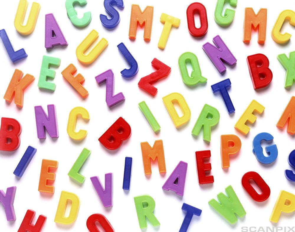 Plastic letters in many colours. Photo.