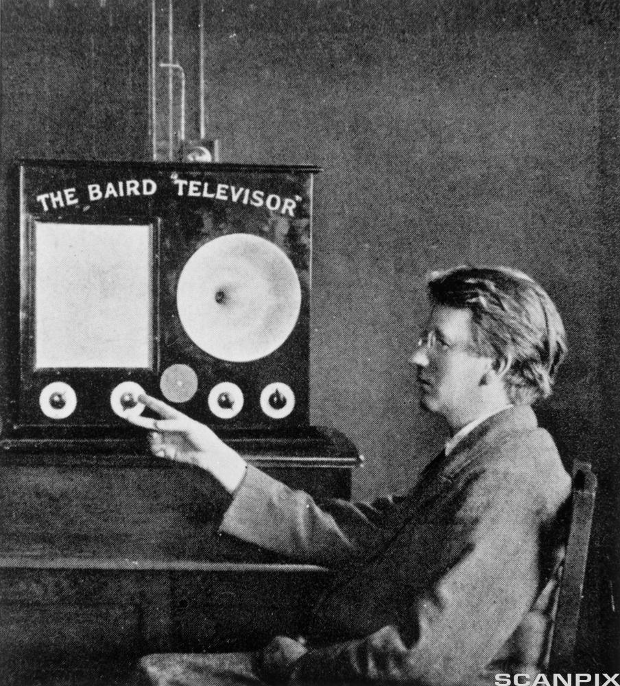 TheBaird 'Televisor'. View of the Scottish electrical engineer John Logie Baird and his invention, the 'Televisor'. The televiso