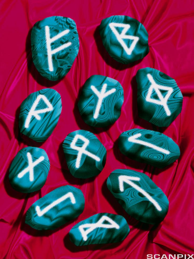 Computer artwork of pebbles marked with runes.