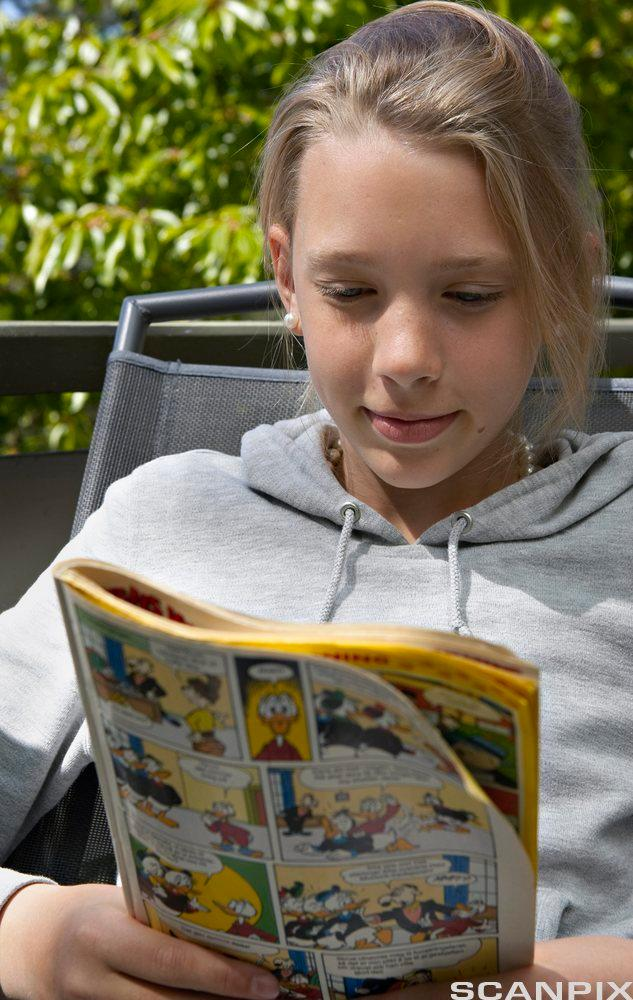 Picture of girl reading comics.