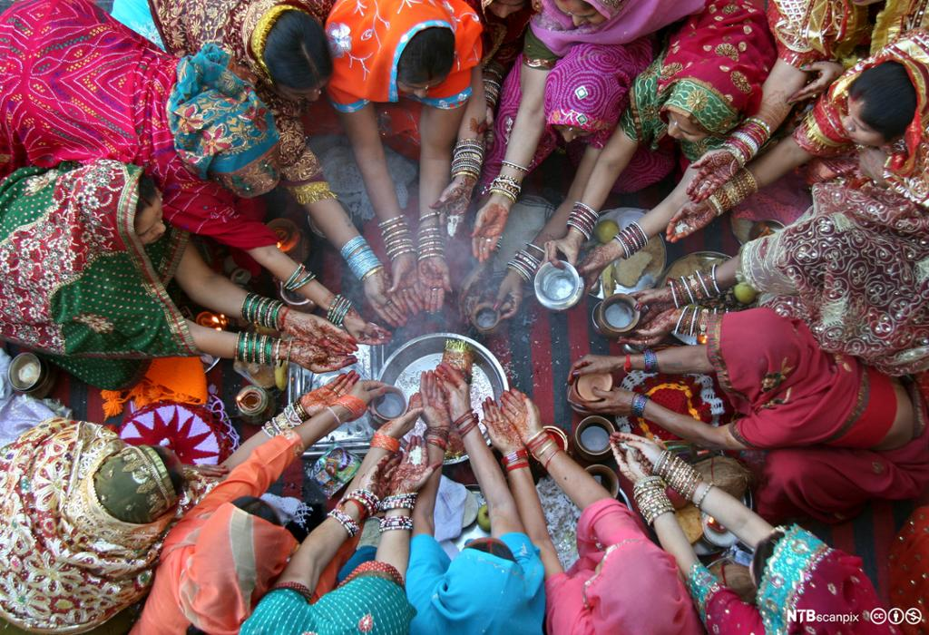 Women pray during the Hindu festival of Karva Chauth inside a temple in the northern Indian city of     Chandigarh