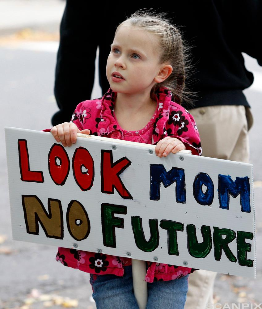 Abigail Garrett, 6, of Hamden, Connecticut holds a sign during an Occupy Wall Street protest.