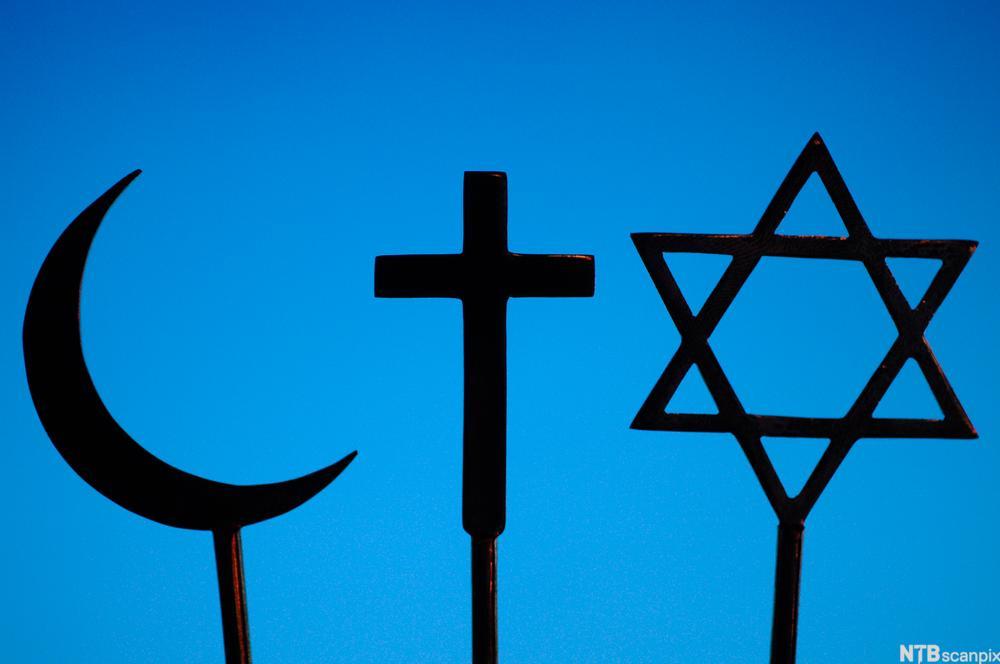 Religiøse symbol: månesigd for islam, korset for kristendom, davidsstjerne for jødedom. Foto.