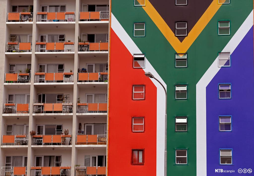 A South African flag banner on the side of an apartment block in the city of Cape Town