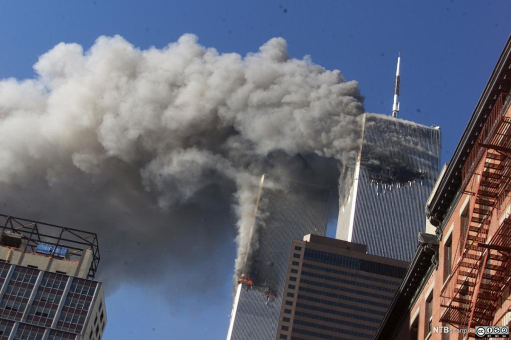 Smoke rising from the burning twin towers of the World Trade Center after hijacked planes crashed into the towers, in New York City.