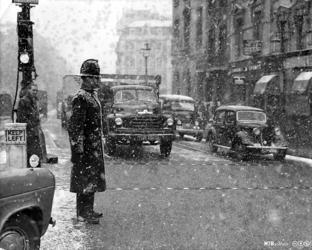 Police officer in snowy London