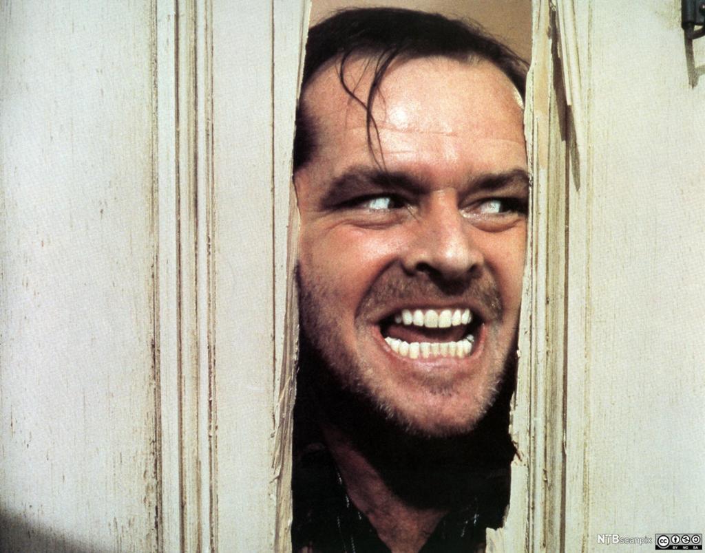 Jack Nicholson i rollen som Jack Torrence i Stanley Kubricks filmatisering av romanen The Shining (1980). Foto.