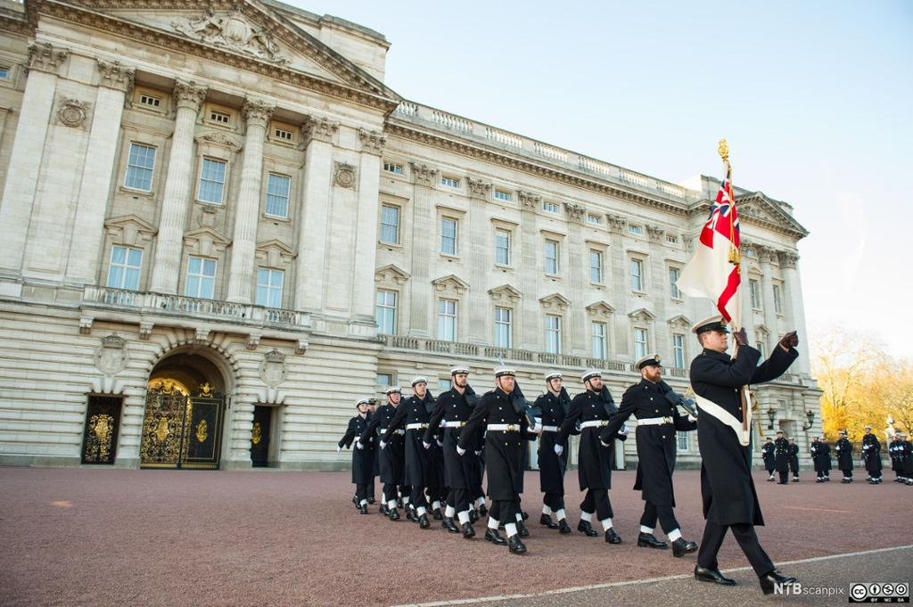 Sailors from the Royal Navy perform the Changing of the Guard ceremony at Buckingham Palace, London
