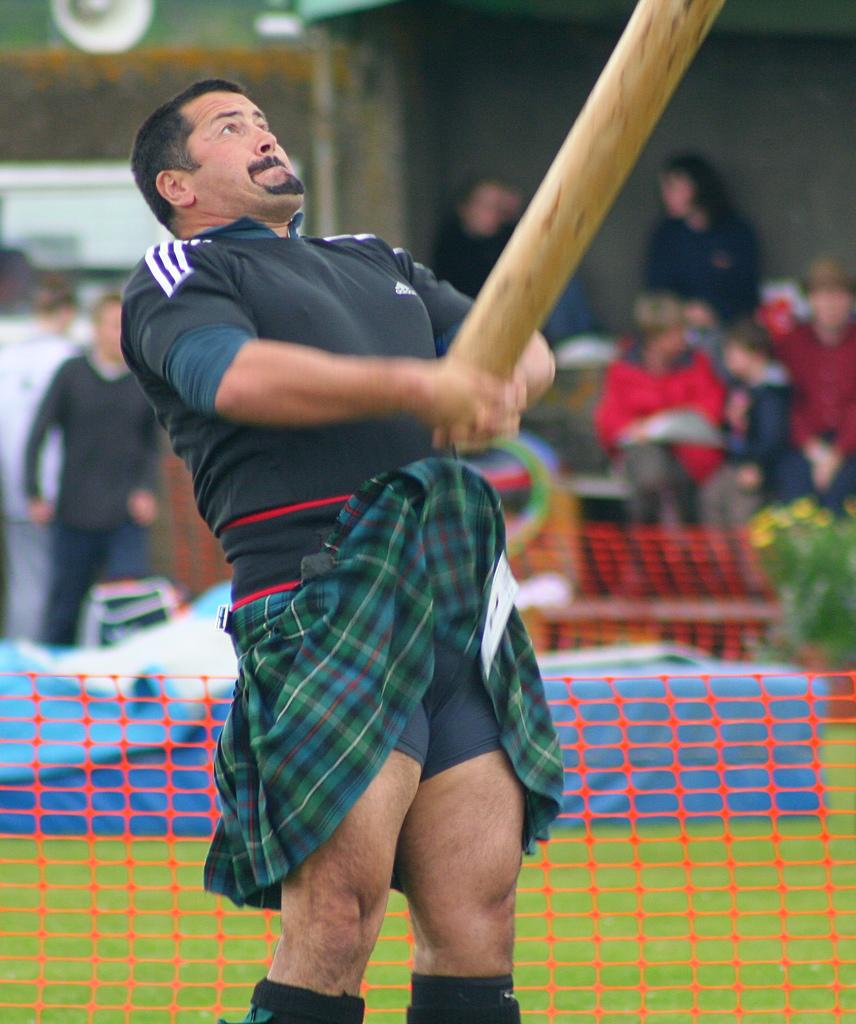 A man tossing a caber. Photo.