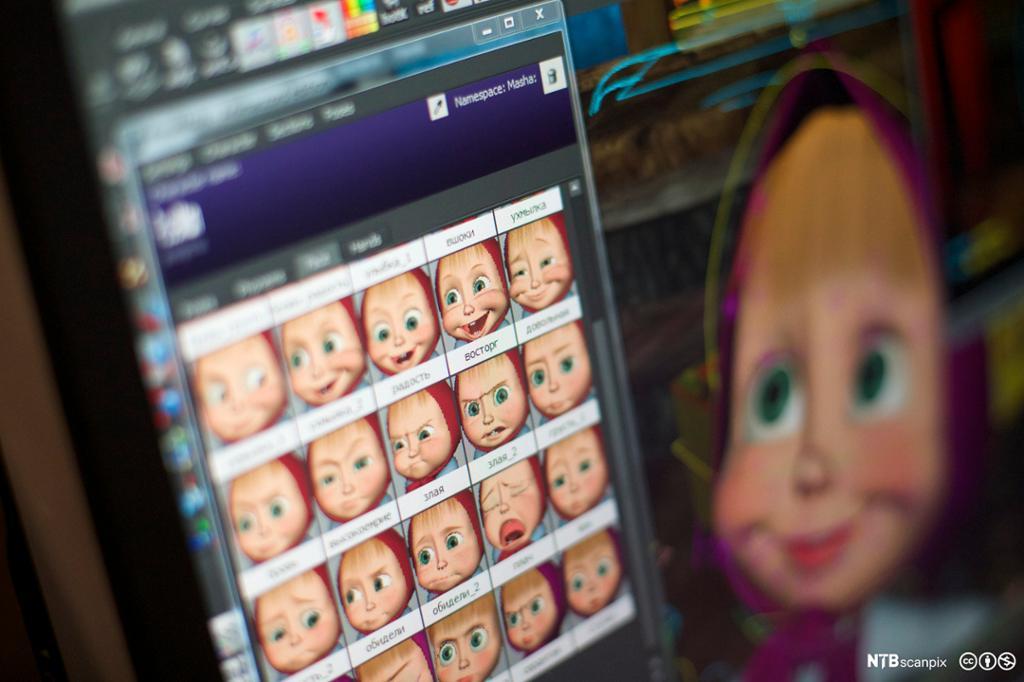 En skjerm viser animasjonsfiguren Masha animert med mange ulike ansiktsuttrykk. Bilde.