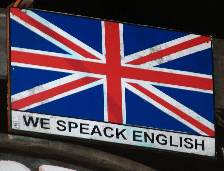 "Poster with English flag and text ""We speack English"". Foto."
