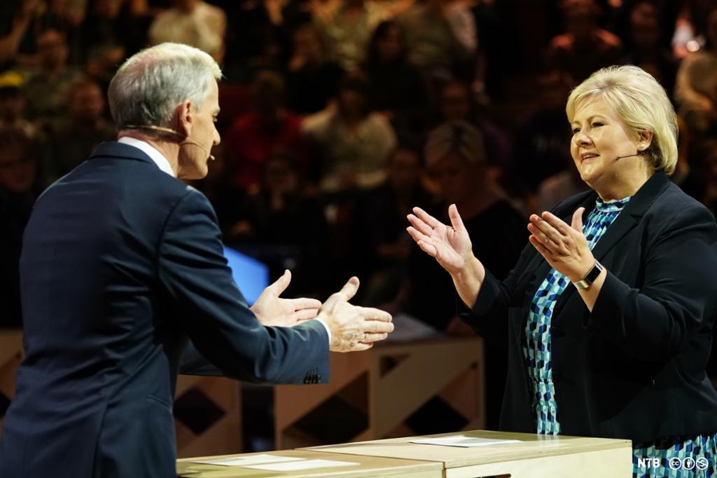 Jonas Gahr Støre og Erna Solberg i debatt. Foto.